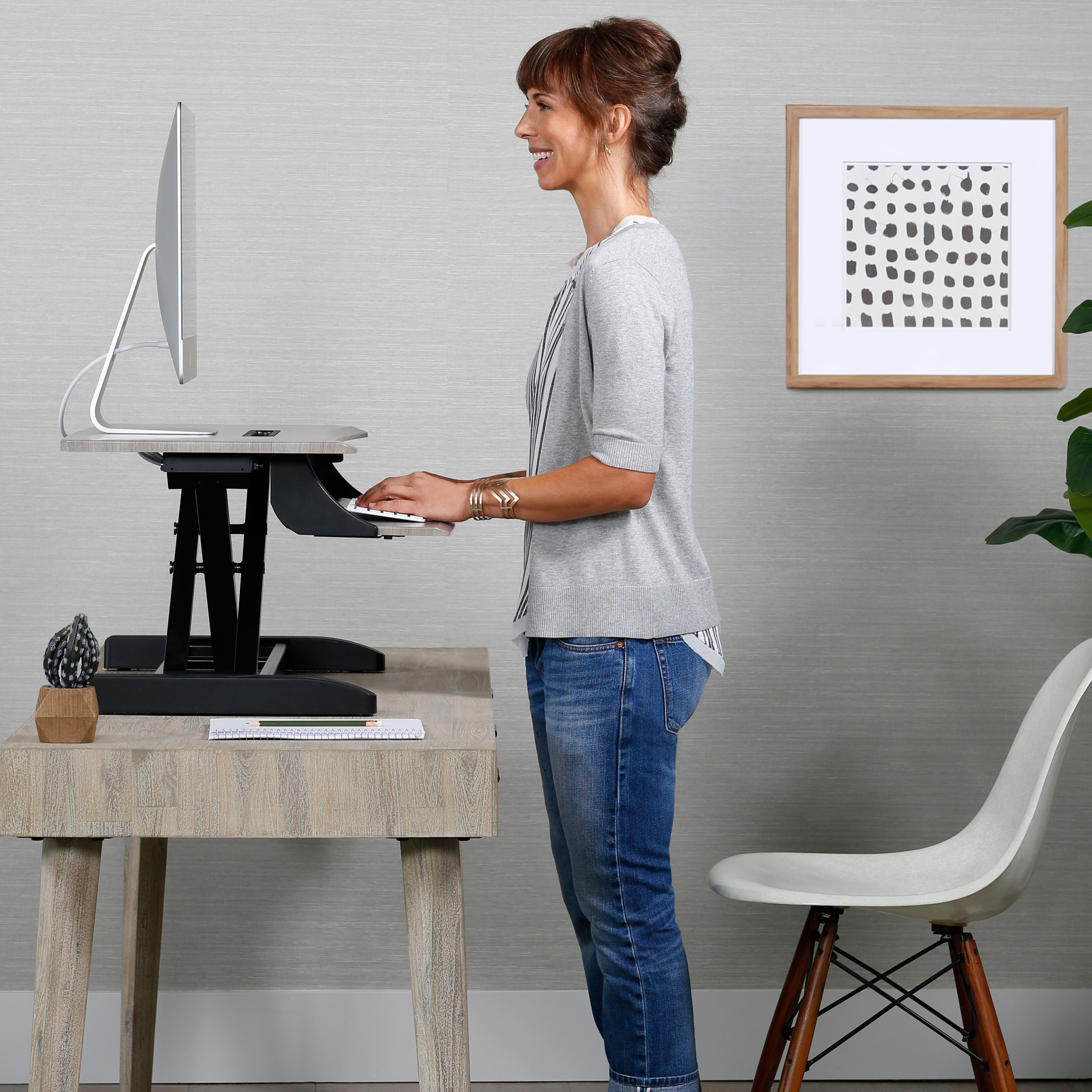 Woman standing at ergotron desk